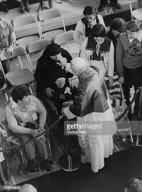 Pope John Paul II blesses members on the congregation at a service for the sick disabled and dying at Southwark Cathedral London on the first day of...