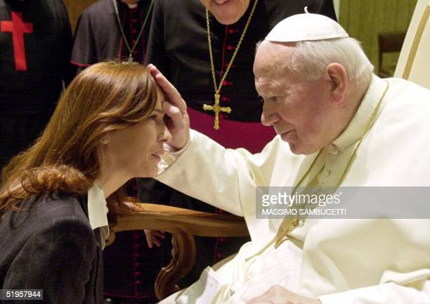 Pope John Paul II blesses US actress Clarissa Burt during a special audience for volunteers active in offering assistance to sick people in the Pope...