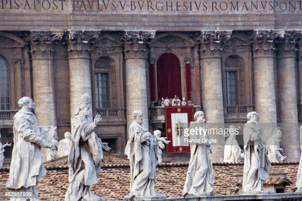Pope John Paul II delivers his Christmas Day message and 'Urbi et Orbi' blessing from the central balcony of St Peter's Basilica framed by statues of...