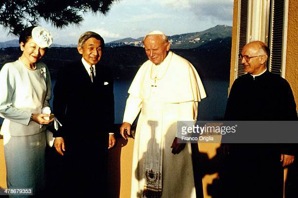 Pope John Paul II flanked by father Giuseppe Pittau meets Emperor Akihito and Empress Michiko of Japan on the terrace of his summer residence...
