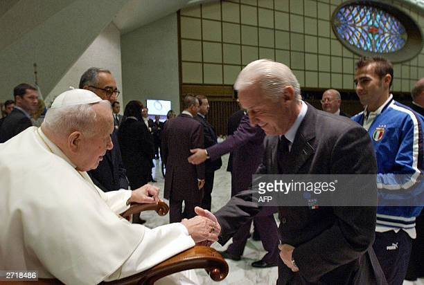 Pope John Paul II greets Italy's national soccer team coach Giovanni Trapattoni as Italy's defender Fabio Cannavaro looks on in the Vatican's Paul VI...