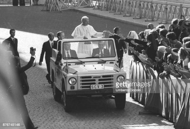 Pope John Paul II greets people at the Vatican City in 1979.