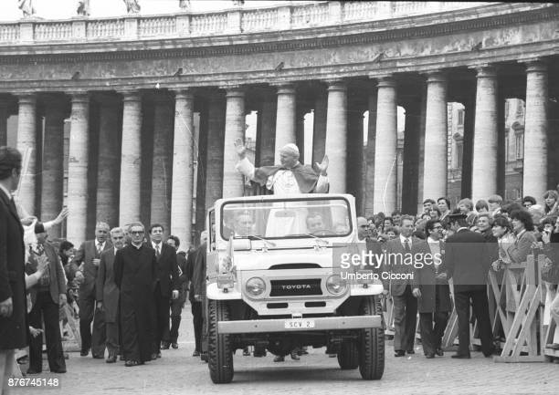 Pope John Paul II greets people at the Vatican City in 1979