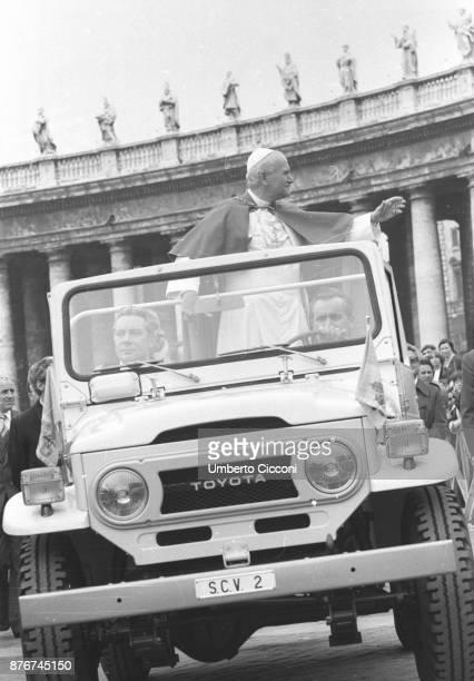 Pope John Paul II greets people at the Vatican City.