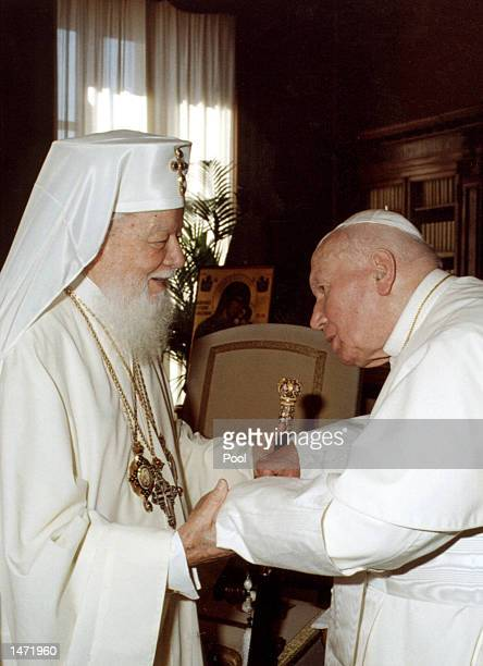 Pope John Paul II greets Romanian Orthodox Patriarch Teoctist during a private visit October 12 2002 in Vatican City Italy The Pope first met with...