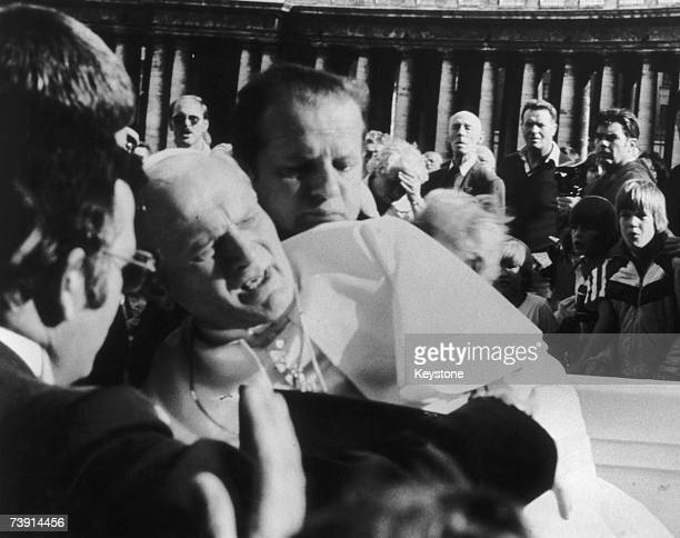 Pope John Paul II in agony after being shot by wouldbe assassin Mehmet Ali Agca in St Peter's Square 13th May 1981
