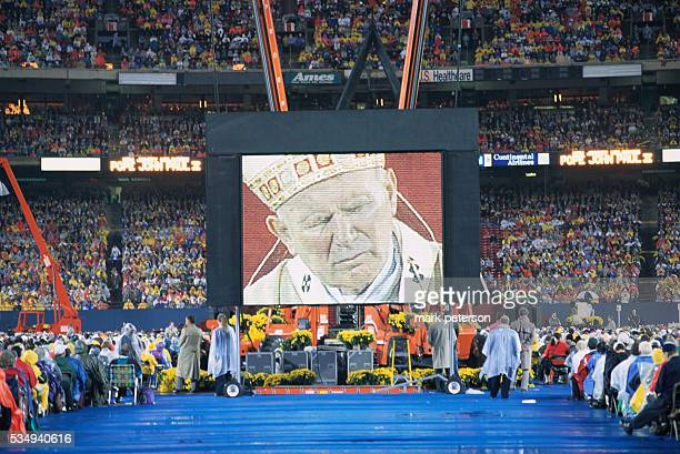 Pope John Paul II is broadcast on a large screen while he celebrates mass at the Meadowlands Sports Complex in East Rutherford New Jersey