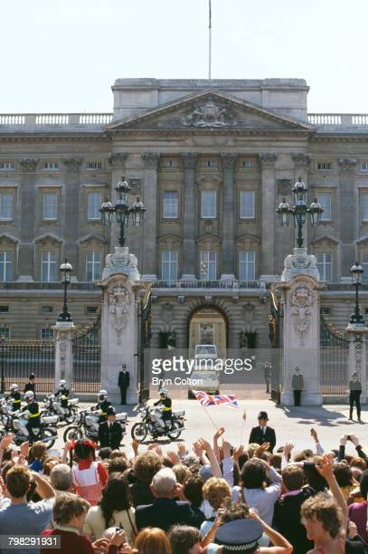 Pope John Paul II leaves Buckingham Palace in the popemobile following his audience with Queen Elizabeth II on the first day of his sixday tour of...