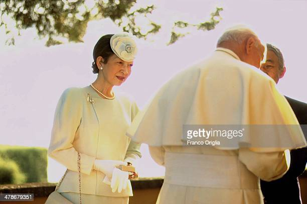 Pope John Paul II meets Emperor Akihito and Empress Michiko of Japan on the terrace of his summer residence overlooking the lake of Albano on...