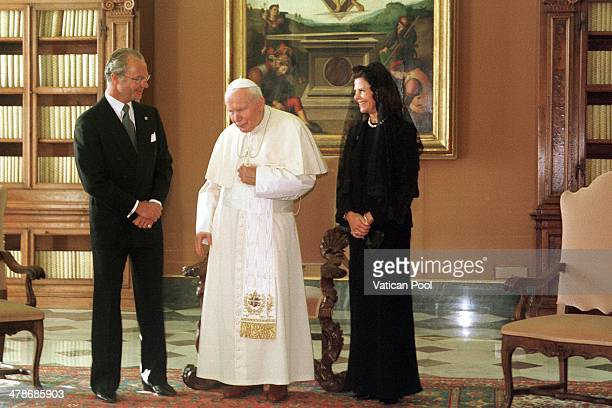 Pope John Paul II meets King Carl XVI Gustaf of Sweden and Queen Silvia of Sweden at his private library in the Apostolic Palace on November 13 1999...