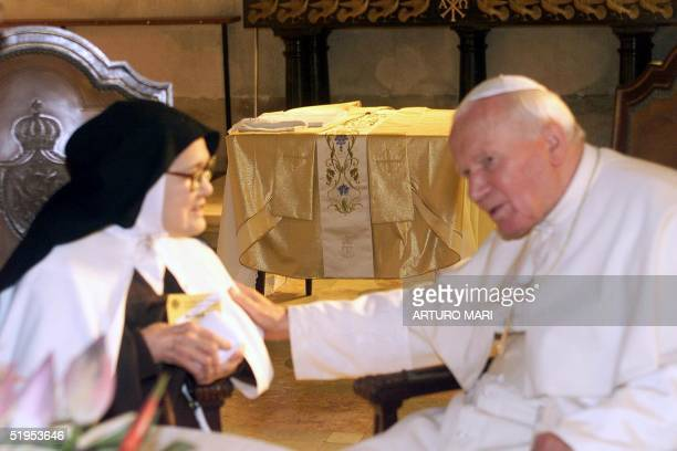 Pope John Paul II meets Sister Santa Maria Lucia of the Immaculate Heart in Fatima 13 May 2000 Pope John Paul II is in Portugal for the beatification...