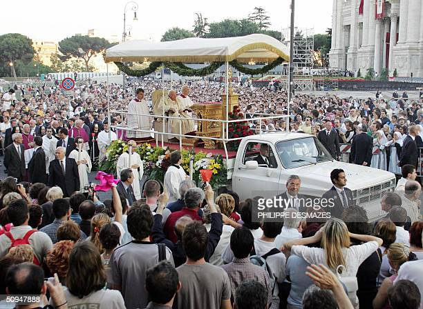 Pope John Paul II on his popemobile passes by pilgrims after an open air mass to celebrate the feast of Corpus Christi in front of Rome's St John in...
