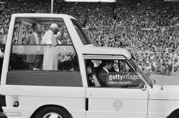 Pope John Paul II on the Popemobile at Crystal Palace during his visit to the UK, London, 30th May 1982.