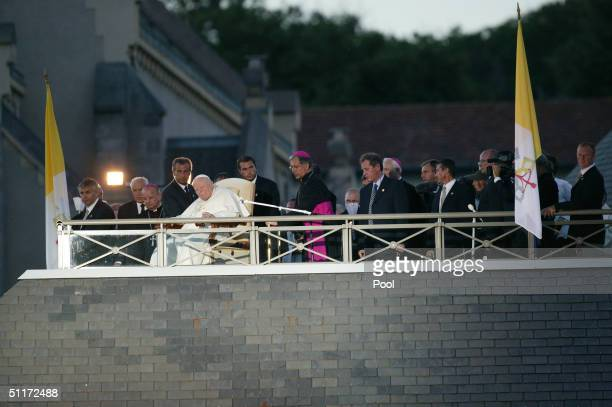 Pope John Paul II oversees a candlelit procession to the Virgin Mary shrine August 14 2004 in Lourdes France Pope John Paul II arrived in Lourdes for...