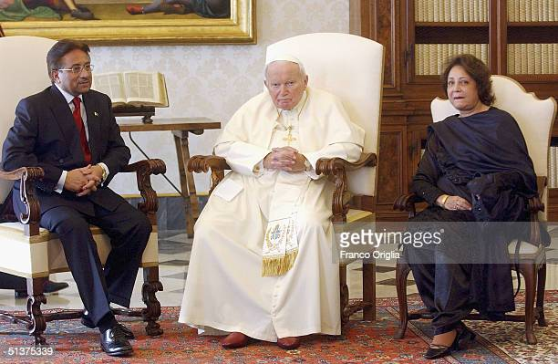 Pope John Paul II poses with Pakistani President Pervez Musharraf and his wife Sehba Farid Musharraf during their meeting on September 30 in Vatican...
