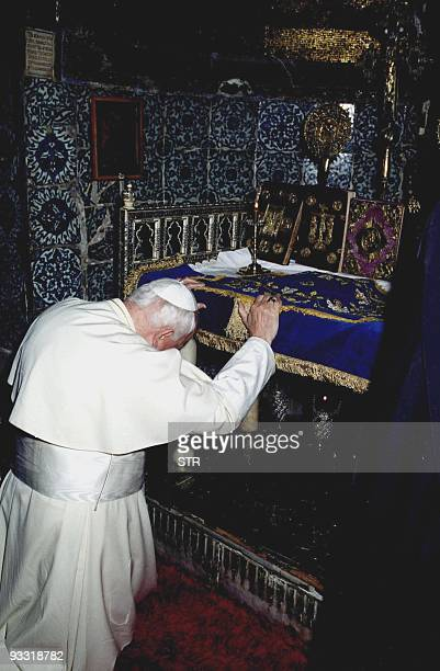 Pope John Paul II prays in front of the altar of St Catherine's Monastery Greek Orthodox during a visit to this biblical site 26 February 2000 The...