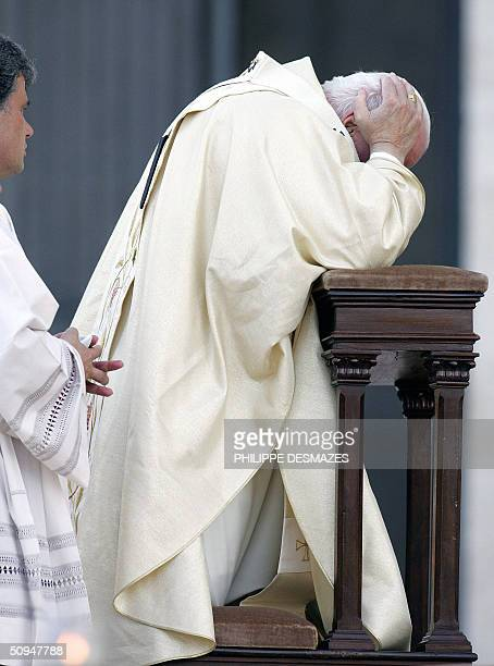 Pope John Paul II prays under the look of his nonce in front of Rome's St John in Lateran basilica as he presides over an openair mass to celebrate...