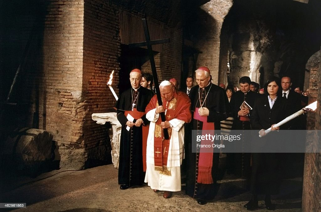 Pope John Paul II presides over the Way of The Cross procession at the Colosseum on Good Friday on April 21, 2000 in Rome, Italy.