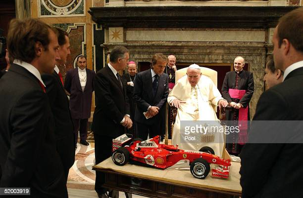 Pope John Paul II receives as a gift from Ferrari President Luca Cordero di Montezemolo, Michael Schumacher, Brazilian teammate Rubens Barrichello,...