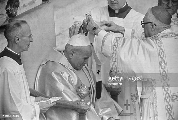 Pope John Paul II receives pallium from Cardinal Deacon Pericle Felici during his investiture ceremony in St. Peter's Square. Also present are...
