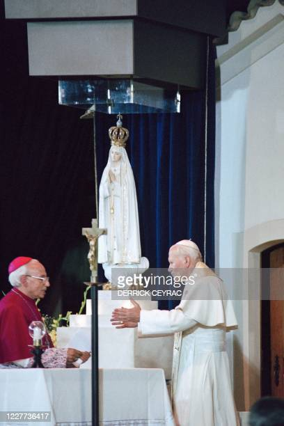 Pope John Paul II salutes at the Chapel of the Apparitions in Fatima's Sanctuary on May 12, 1991 in Fatima.