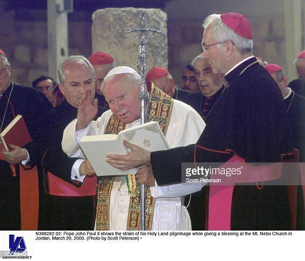 Pope John Paul II shows the strain of his Holy Land pilgrimage while giving a blessing at the Mt Nebo Church in Jordan March 20 2000