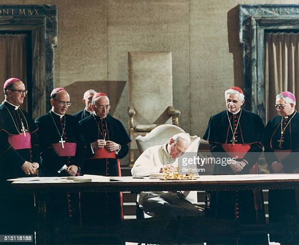 Pope John Paul II signs the new Roman Catholic Code of Canon Law Msgr Bruno Fagiolo of the Vatican Secretariat Msgr Martinez Somal Vatican...