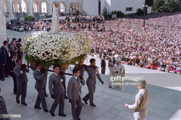 Pope John Paul II stands in front of the statue of Virgin of Fatima on May 12, 1991 in Fatima.