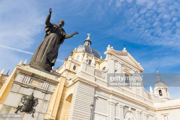 Pope John Paul II statue in front of Cathedral Almudena of Madrid, Spain.