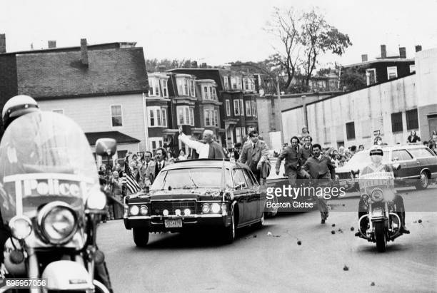 Pope John Paul II surrounded by Secret Service agents waves from an open car in Preble Circle South Boston on Oct 1 1979