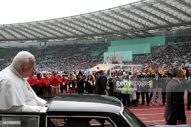 Pope John Paul II takes a lap around the Olympic Stadium of Rome after attending a mass and an exhibition soccer match between Italy National Team...