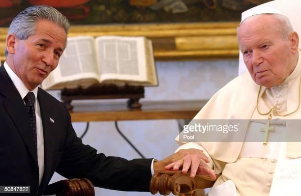 Pope John Paul II talks with President Ricardo Maduro of Honduras during their meeting May 17 2004 in Vatican City