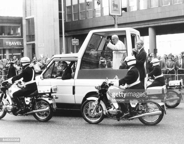 Pope John Paul II Visit to Britain 1982 the Pope waves to the crowds lining his route through London from his pope mobile