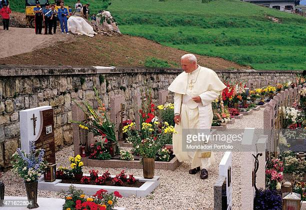 Pope John Paul II visiting a cemetery 1990s