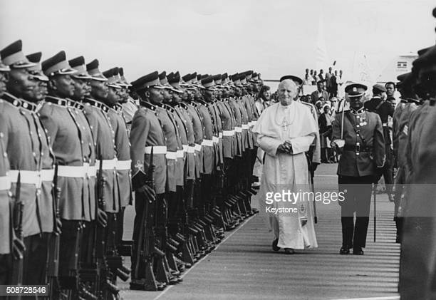 Pope John Paul II walking with President Daniel Arap Moi inspecting a Guard of Honor on his arrival at Jomo Kenyatta Airport Nairobi May 7th 1980