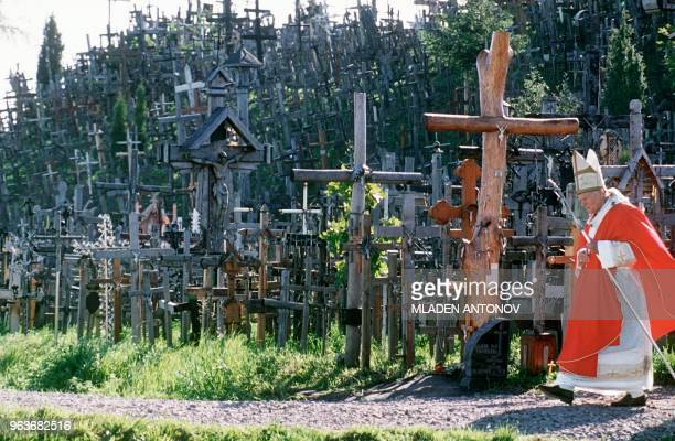 Pope John Paul II walks past the Hill of Crosses one ot the most famous places of pilgrimage for lithuanian catholics near the city of Siauliai 07...