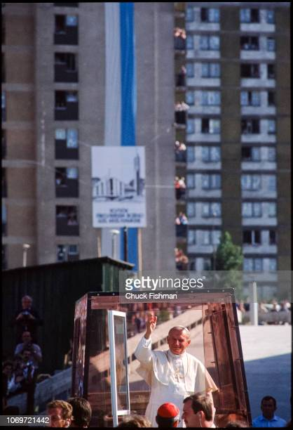 Pope John Paul II waves from his 'popemobile' vehicle while driving through the industrial suburb of Nowa Huta, Krakow, Poland, June 22, 1983. He was...