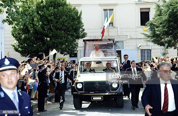 Pope John Paul II waves to the faithful fom his Popemobile during his official visit to Sicily on May 10 1993 in Mazara del Vallo Sicily