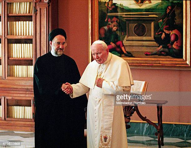 """""""Pope John Paul II welcoming the President of Iran Mohammad Khatami visiting Vatican for the first time in the private library. Vatican City, 1999 """""""