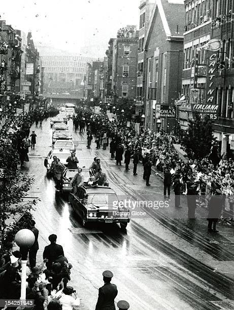 Pope John Paul II's motorcade drove through the North End where almost 60000 people lined Hanover Street Confetti fell amid choruses of 'Vive Il...