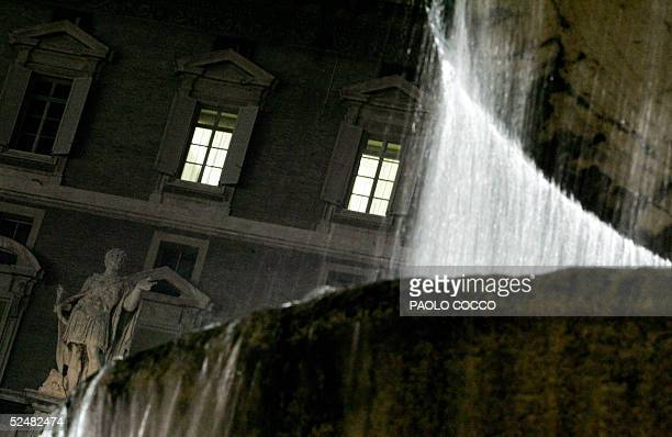 Pope John Paul II's studio windows are lit at night at the Vatican 26 March 2005. Though he was once again absent from an Easter ceremony Saturday,...