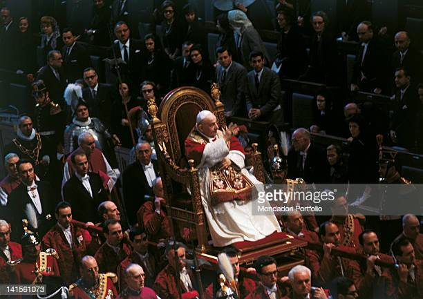 Pope John XXIII, born Angelo Roncalli, sitting on the sedan chair during his last trip outside the Vatican. Vatican City, 11th May 1963