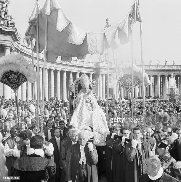 Pope John XXIII is carried ceremoniously to St Peter's Basilica for the inauguration of the 21st Ecumenical Council the Second Vatican Council which...