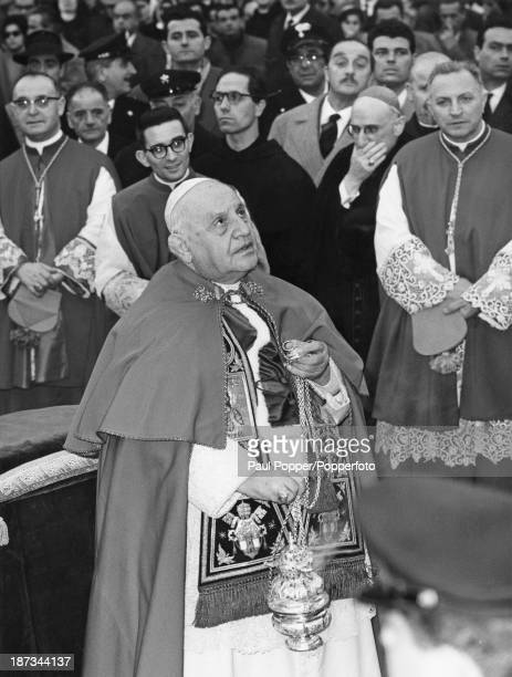 Pope John XXIII spreads incense at the foot of the Column of the Immaculate Conception in the Piazza di Spagna, Rome, 8th December 1961. The pope is...