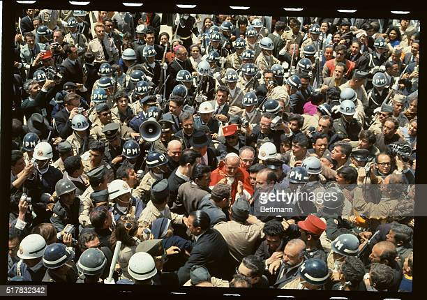 Pope Paul VI is swallowed by a crowd of Colombians including many soldiers and policemen as he meets the people here 8/22 for the International...