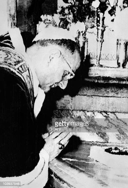 Pope Paul VI prays on the Holy Sepulchre where Jesus is believed to be buried during a mass in the Church of the Holy Sepulchre in the Old City of...
