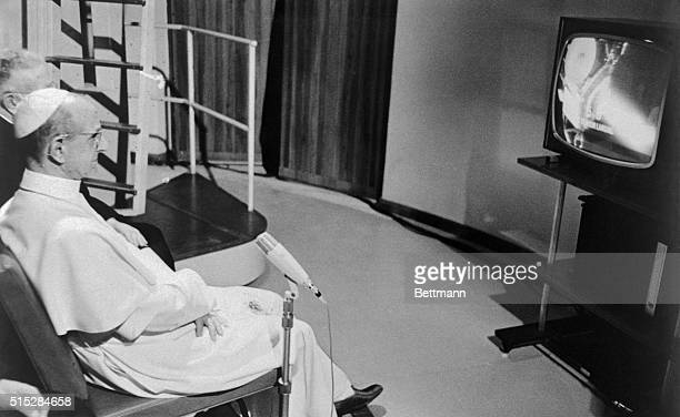 Pope Paul VI sits before a television set in his summer villa here July 20th and watches the astronauts Neil Armstrong and Buzz Aldrin land on the...