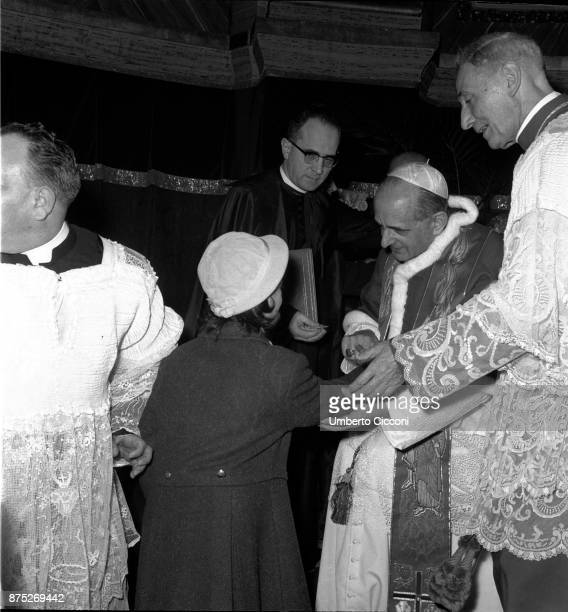 Pope Paul VI talks to a young girl during the celebration of Mass in St Peter's Basilica in 1964