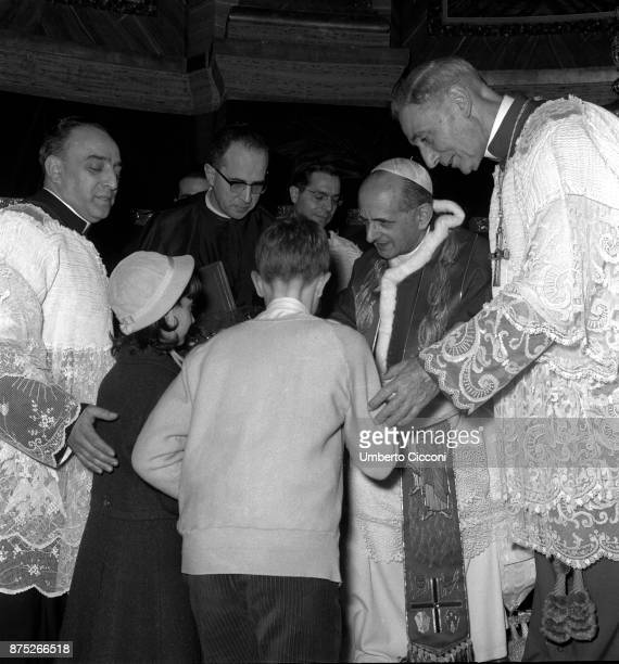 Pope Paul VI talks to children during the celebration of Mass in St Peter's Basilica in 1964