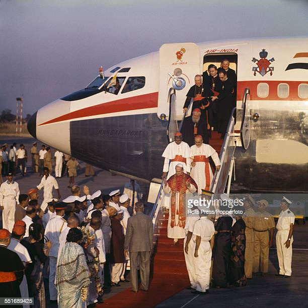 Pope Paul VI walks down the steps from an Air India aeroplane at Bombay airport at the start of the Official Papal Visit by Pope Paul VI to India on...